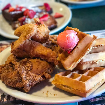 A plate of fried chicken and waffles from Metro Diner in Matthews, NC.