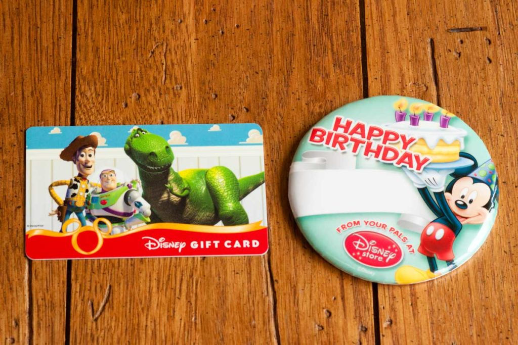 A Disney gift card and birthday button.