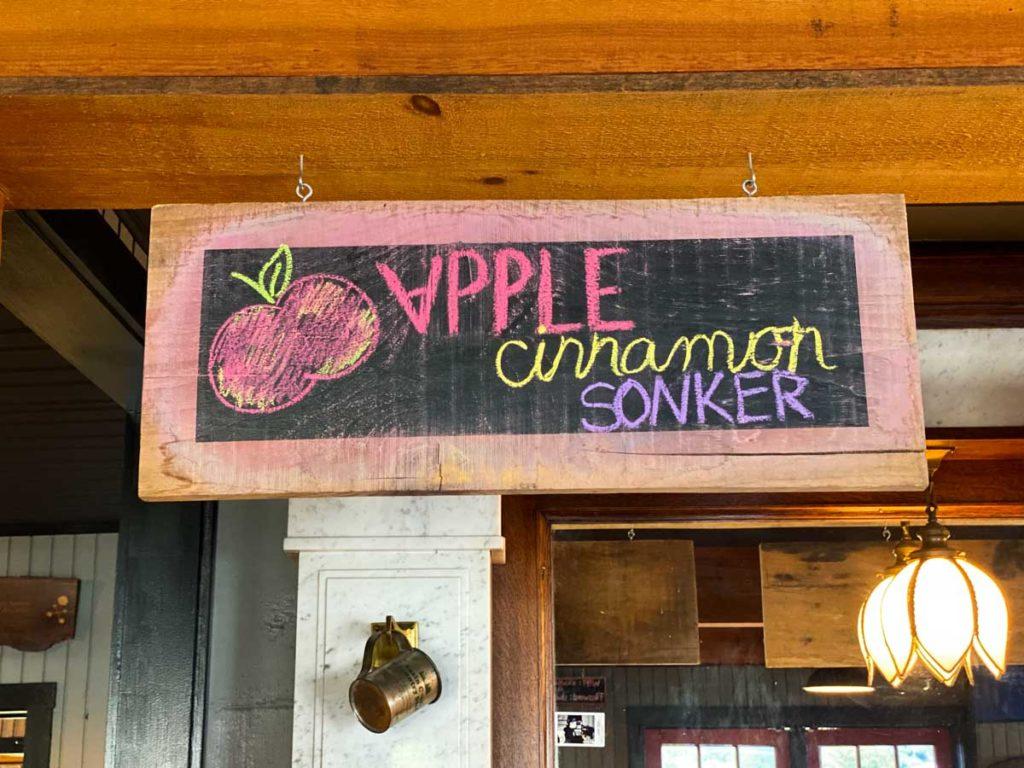 """A hand decorated chalkboard reads """"Apple Cinnamon Sonker"""""""